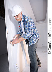 builder plastering the wall