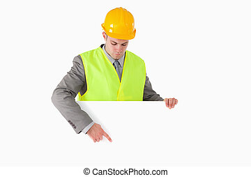 Builder pointing at something