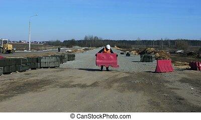 Engineer inspector puts Barrier buffer during road building or road repair work