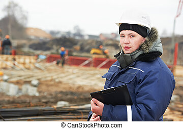 builder resident engineer at construction site