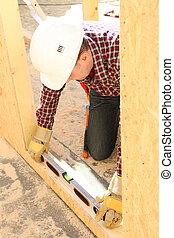 Builder using a bubble level