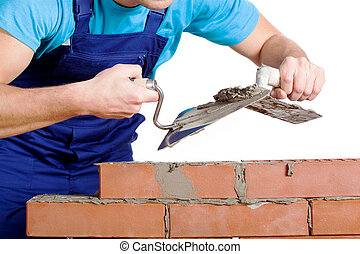 Builder using a cement and trowel