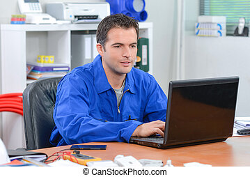 Builder using a laptop computer