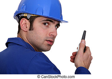Builder using a walky talky