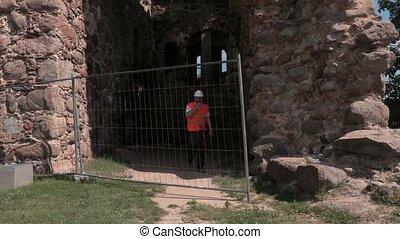 Builder walking through the castle yard