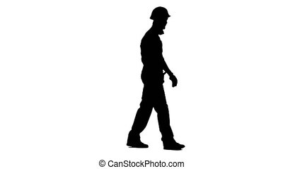 Builder walks and waves to his workers, showing a thumbs up. White background. Silhouette. Side view