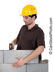 Builder with a block wall