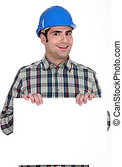 Builder with a board left blank for your message