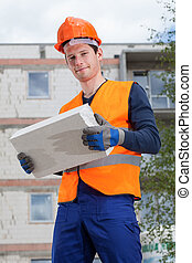 Builder with a brick