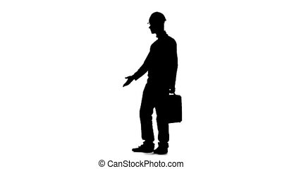 Builder with a diplomat in his hands and a helmet on his head. Silhouette. White background. Slow motion