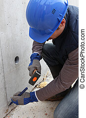 Builder with a hammer and chisel