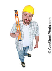 Builder with a spirit level