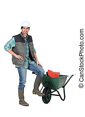 Builder with a wheelbarrow