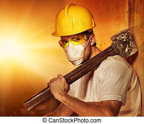 Builder with big metal hammer
