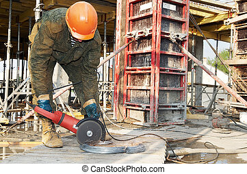 Builder with circular abrasive saw - Builder works with...