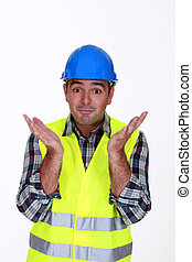 Builder with confused look on face
