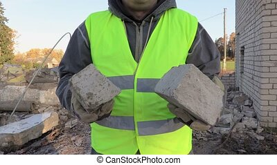 Builder with damaged bricks
