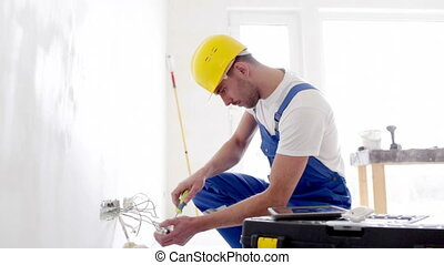 builder with tablet pc and equipment indoors - building, ...