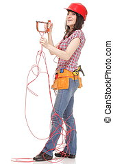 Builder woman in red helmet cut red entangled cable