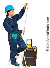 Builder woman making measurements