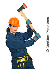 Builder woman working with ax