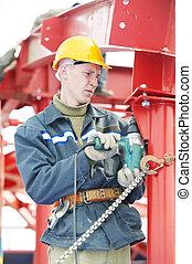 builder worker assembling metal construction - builder...