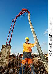 builder worker at concrete pouring work - builder worker...