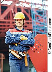 builder worker at construction site - builder worker in...