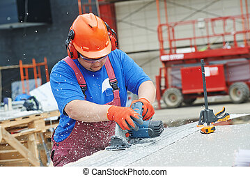 Builder worker at construction site - Builder worker with ...