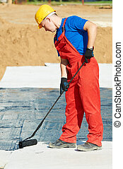 builder worker at roof insulation work - builder worker in ...