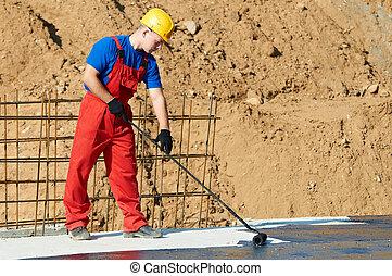 builder worker at roof insulation work