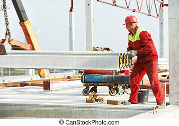 builder worker installing concrete slab - builder worker in...