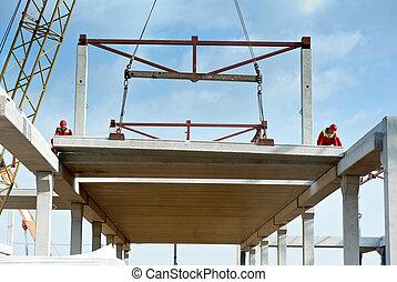 builder worker installing concrete slab - builder worker in...
