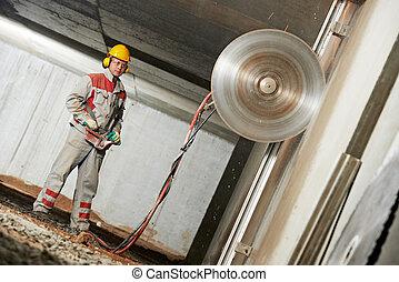 builder worker operating demolition machine - builder worker...