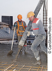 builder worker pouring concrete into form