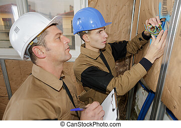 builder working with electricity indoors