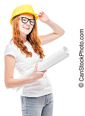 Builder young woman with projects in a yellow hard hat against a white background