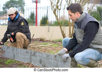 Builders at work in a garden