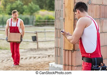Builders during hard physical work - Photo of two strong ...