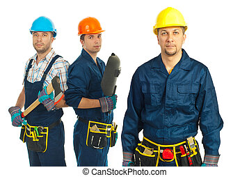 Mid adult builder man standing in front of his team against white background