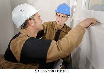 builders sharing a joke