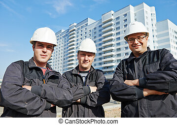 Builders team at construction site