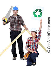 Builders with a recycle sign
