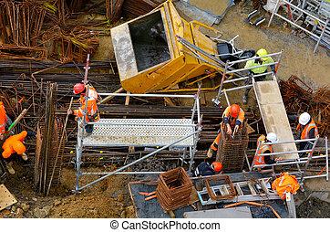 Builders work in construction building site