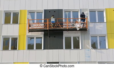 Builders working on elevator at building site