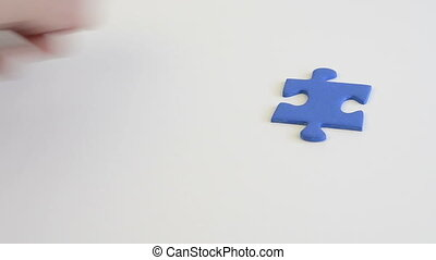 building a jigsaw of blue pieces