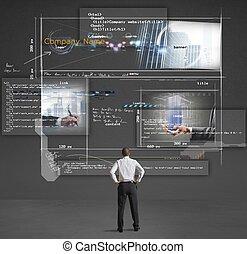 Building a website - Businessman shows a presentation of a...