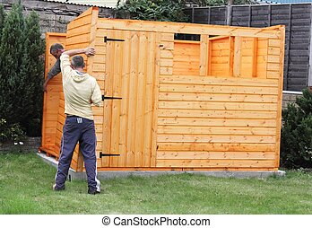 Building a wooden shed and fixing the sides together