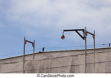 Building activity. Construction site with crane. - Building...