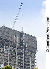 Building and crane under construction